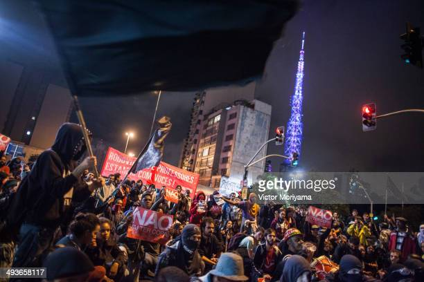 Members of Anarchist Black Bloc hold a peaceful protest against the World Cup Football on May 24 2014 in Sao Paulo Brazil Demonstrators protested...