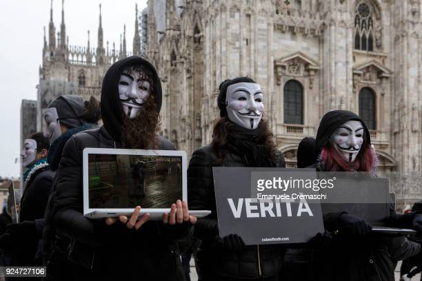 Members of Anonymous for the Voiceless wearing Guy Fawkes mask perform 'The Cube of Truth' a static protest which consists in holding laptops...