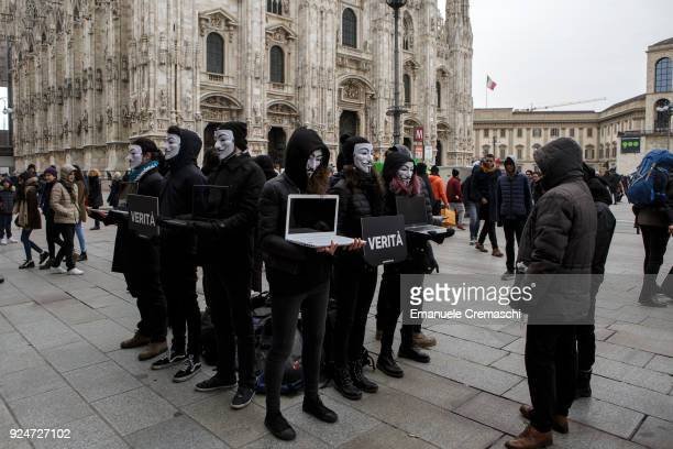 Members of Anonymous for the Voiceless wearing Guy Fawkes masks perform 'The Cube of Truth' a static protest which consists in holding laptops...
