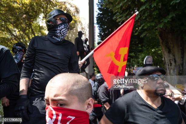 Members of Antifa and other leftwing protesters watch far right protesters on the other side of the street during the Patriot Prayer Rally The Proud...