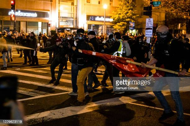 Members of Antifa and Proud Boys clash in the middle of the street following the Million MAGA March on November 14 2020 in Washington DC Various...