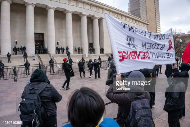 Members of Antifa march from City Hall to the Ohio Statehouse after President Joe Biden was sworn into office in the wake of the Coronavirus COVID-19...
