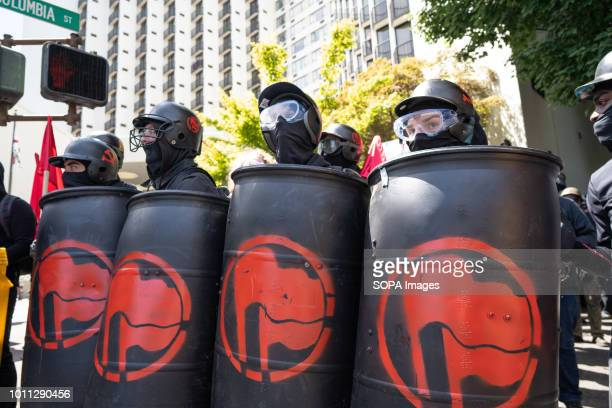Members of Antifa watch police and far right protesters during the Patriot Prayer Rally The Proud Boys organized the Patriot Prayer Rally in Portland...
