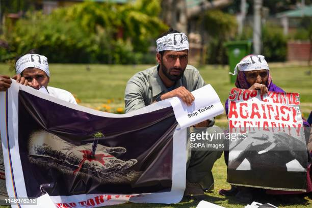 Members of APDP hold a banner and placards during a protest in Srinagar The Association of Parents of Disappeared Persons is observing the...