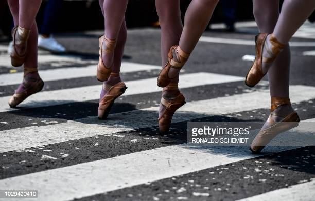 Members of Ardentia dance company, perform at Reforma Avenue, in Mexico City, on September 8 during an activity to get classical dance known outside...