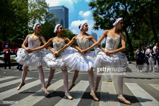 TOPSHOT Members of Ardentia dance company perform at Reforma Avenue in Mexico City on September 8 during an activity to get classical dance known...