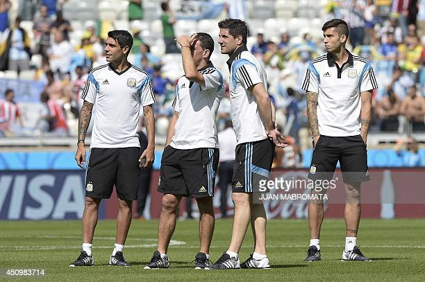 Members of Argentina's squad check the pitch prior to a Group F football match between Argentina and Iran at the Mineirao Stadium in Belo Horizonte...