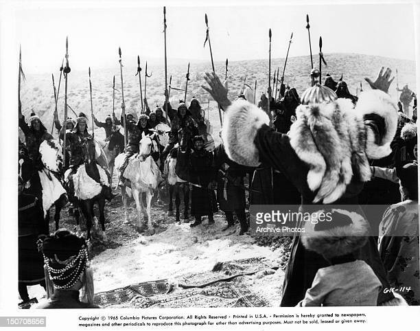 Members of army raise their weapons in a scene from the film 'Genghis Khan' 1965