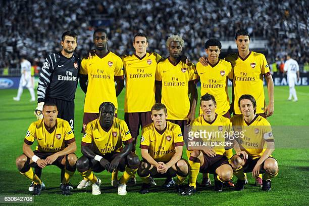 Members of Arsenal football team pose before their UEFA Champions League Group H football match against Partizan at the Partizan Stadium in Belgrade...