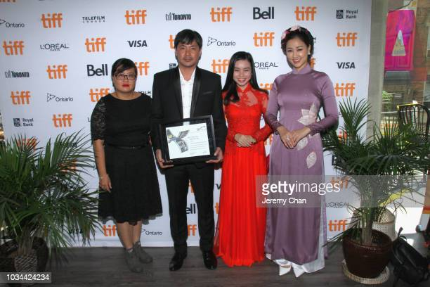 Members of Ash Mayfairs team pose with the NETPAC Award for Best Asian Film for 'The Crossing' at the 2018 TIFF Awards Ceremony at TIFF Bell Lightbox...
