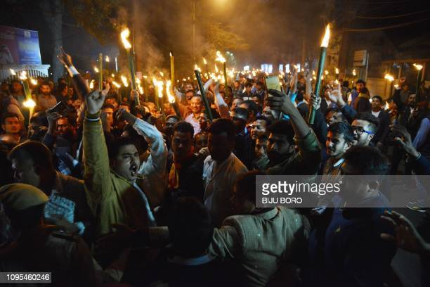 Members of Asom Gana Parishad party clash with police personnel during a torch light procession to protest against the Citizenship Amendment bill...