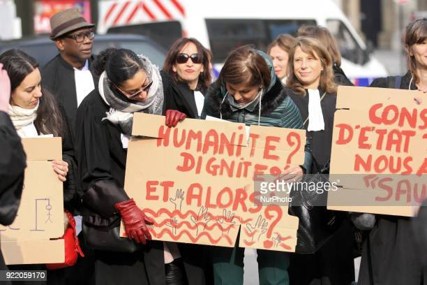 Members of associations rally to protest against a French bill relating to the right of asylum and immigration outside the Council of State in Paris...
