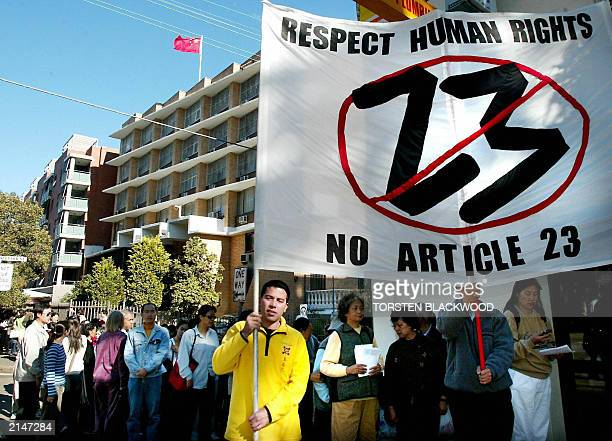 Members of Australia's Chinese community protest against Hong Kong's Article 23 legislation outside the Chinese consulate in Sydney 29 June 2003...