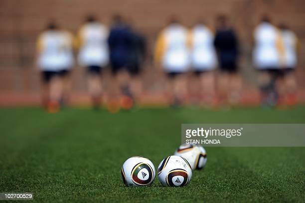 Members of Australia's football squad run during a team training session at Ruimsig Stadium in Roodepoort on June 14 2010 during the 2010 World Cup...