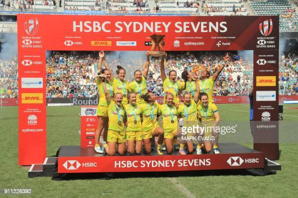 Members of Australia's women's rugby team pose with the trophy after beating New Zealand in the final on day three of the Sydney World Rugby Sevens...