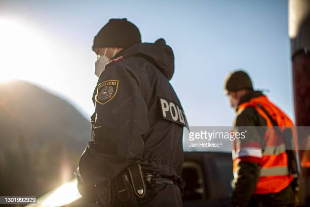 Members of Austria's border police and the Austrian army speak to a driver at a checkpoint on the border to Germany following new border policies in...