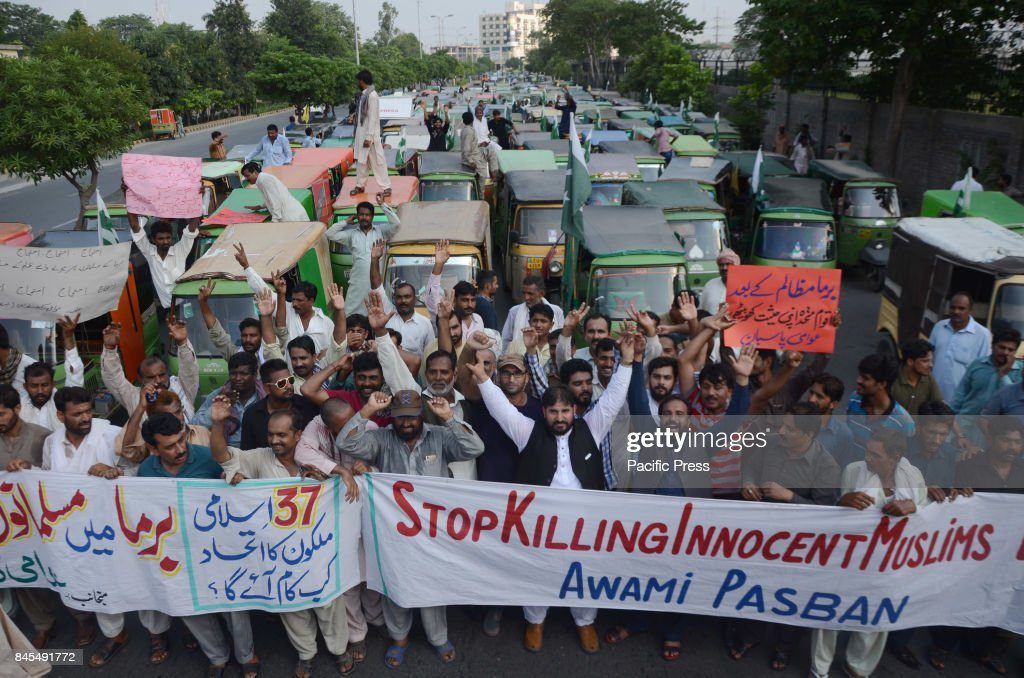 Members of Awami Rickshaw Union Pakistan chant slogans while protesting against the killing of Rohingya Muslims in Burma in Lahore More than 1000...