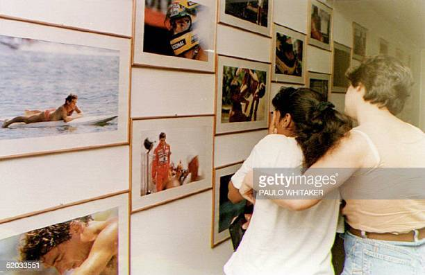 Members of Ayrton Senna's fan club view pictures of him and mourn 01 May 1994 in Sao Paulo Brazil after Senna was killed in a crash at the San Marino...