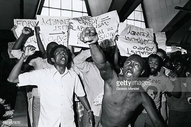 Members of AZAPO an antiapartheid organization with strongly socialist black consciousness leanings protest against the visit to South Africa by...