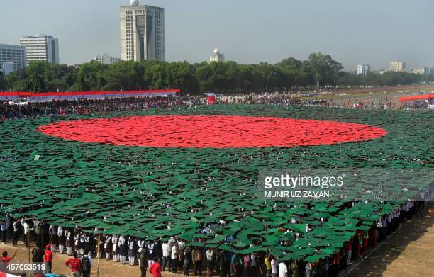 Members of Bangladesh Army Defense officials and schoolchildren form the worlds largest human national flag to mark the country's Victory Day in...