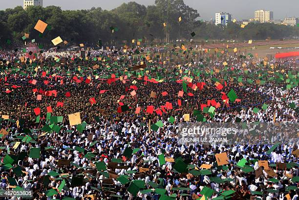 Members of Bangladesh Army Defense officials and schoolchildren celebrate after forming the worlds largest human national flag in a bid to breach the...