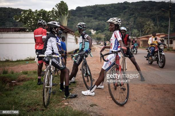 Members of Bangui's cycling team wait prior to taking part in a weekly training session in Bangui on October 26 2017 The country is chronically...