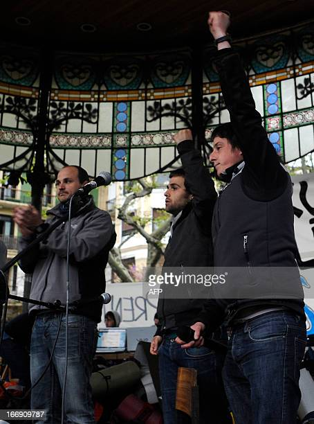 Members of Basque proindependence youth organization SEGI Oier Lorente Egoi Alberdi and Aitor Olaizola raise their fist after delivering a speech in...