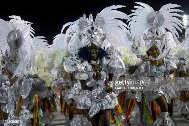 Members of Beija Flor samba school perform during the last night of Rio's Carnival parade at the Sambadrome Marques de Sapucai in Rio de Janeiro,...