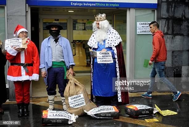 Members of Berri Otxoak platform against social exclusion and in favour of social rights wearing costumes of one of the Three Wise Men Santa Claus...