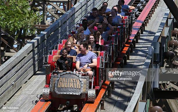Members of Big Brothers Big Sisters ride Goliath the worldÕs tallest steepest and fastest wooden roller coaster at Six Flags Great America thanks to...