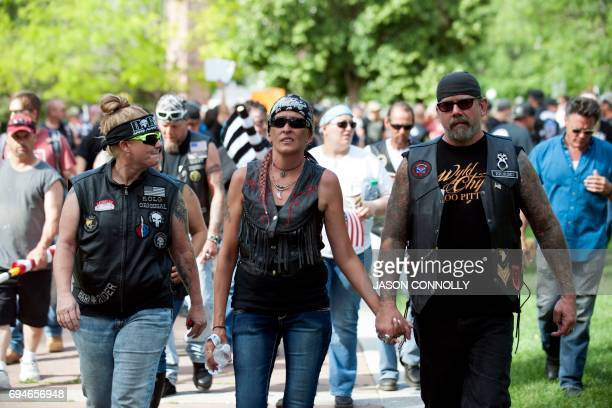 Members of Bikers Against Radical Islam leave the Denver March Against Sharia Law in Denver Colorado on June 10 2017 The march was supported by two...