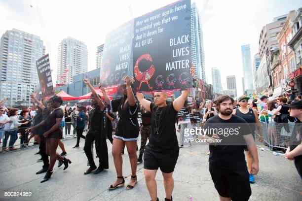 Members of Black Lives Matter march in the Pride Parade in Toronto Ontario June 25 2017 The event draws hundreds of thousands of spectators every...