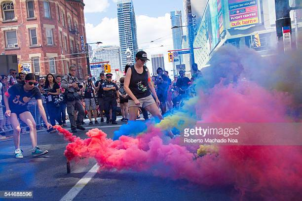 Members of Black Lives Matter planted colorful smoke to call attention Later they announce they were interrupting the parade till their demands were...