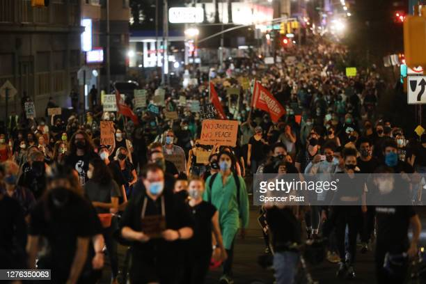 Members of Black Lives Matters are joined by hundreds of others during an evening protest against the Kentucky grand jury decision in the Breonna...