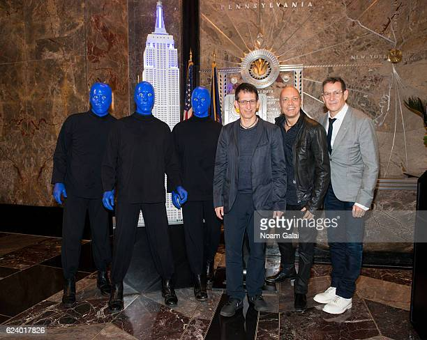 Members of Blue Man Group and Blue Man Group CoFounders and original members Matt Goldman Phil Stanton and Chris Wink light the Empire State Building...