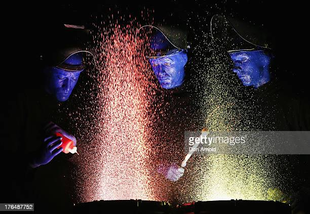 Members of Blue Man Group perform during a photo call at Lyric Theatre Star City on August 14 2013 in Sydney Australia Blue Man Group are a...