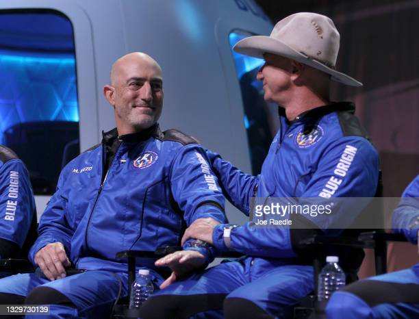 Members of Blue Origin's New Shepard crew Mark Bezos, and brother Jeff Bezos attend a press conference after flying into space in the Blue Origin New...
