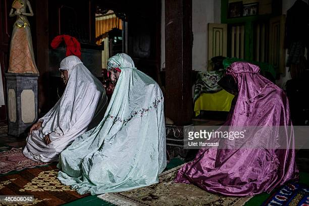 Members of boarding school for transgenders known as pesatren 'waria' called AlFatah pray during Ramadan on July 12 2015 in Yogyakarta Indonesia...