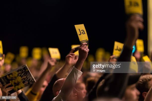 Members of Borussia Dortmund raise their election card during the annual general meeting of German first division Bundesliga football club Borussia...
