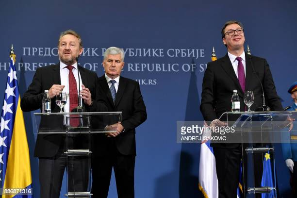Members of Bosnia and Herzegovina's tripartite Presidency Bakir Izetbegovic and Dragan Covic attend a joint press conference with Serbian President...