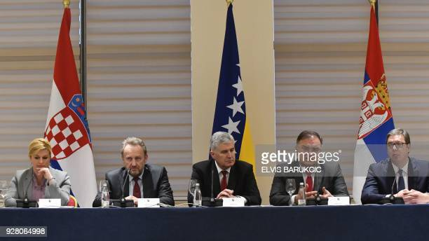 Members of Bosnia and Herzegovina's tripartite Presidency Dragan Covic Bakir Izetbegovic and Mladen Ivanic and their guests President of Serbia...