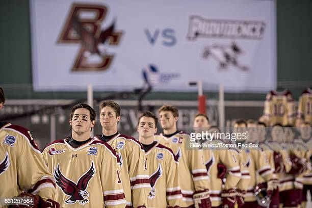 Members of Boston College line up during the National Anthem before a Frozen Fenway game against Providence University at Fenway Park on January 8...