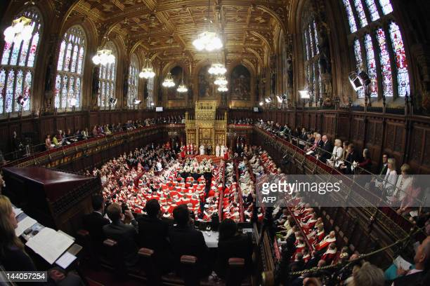 Members of both houses of parliament fill the Chamber of the House of Lords as Britain's Queen Elizabeth II seated on the throne next to Prince...