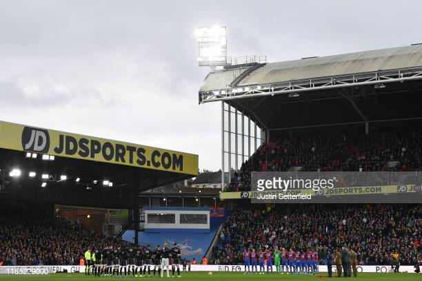 Members of both sides hold a minutes silence prior to kick off during the Premier League match between Crystal Palace and Leicester City at Selhurst...