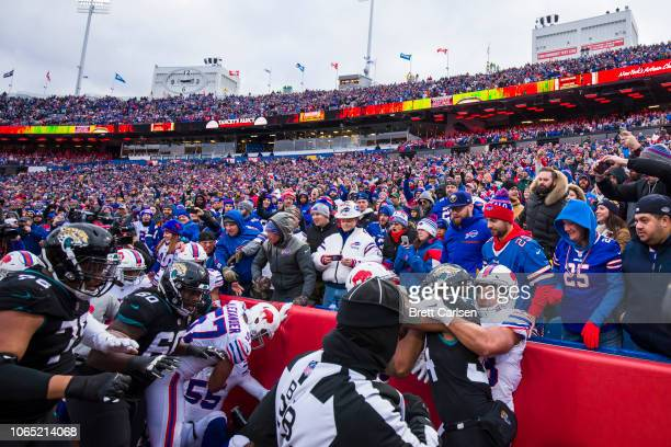 Members of both teams scuffle during the third quarter of the game between the Buffalo Bills and the Jacksonville Jaguars at New Era Field on...