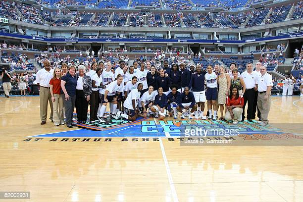 Members of both the New York Liberty and the Indiana Fever pose for a photo at center court at the 2008 Liberty Outdoor Classic on July 19 2008 at...