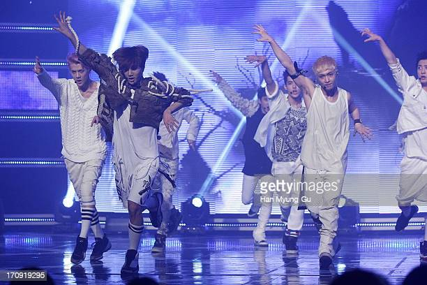 Members of boy band EXO perform onstage during the MBC Music 'Show Champion' at Uniqlo AX Hall on June 19 2013 in Seoul South Korea