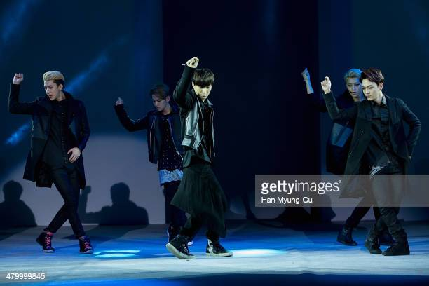 Members of boy band EXOK perform onstage the Seoul Fashion Week A/W 2014 at DDP on on March 21 2014 in Seoul South Korea