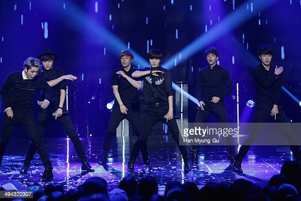 Members of boy band Infinite perform onstage during the MBC Music 'Show Champion' on May 28 2014 in Seoul South Korea
