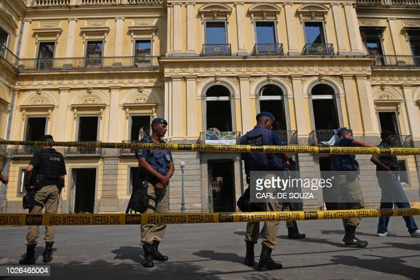 Members of Brazil security forces stand guard in front of Rio de Janeiro's treasured National Museum one of Brazil's oldest on September 3 a day...